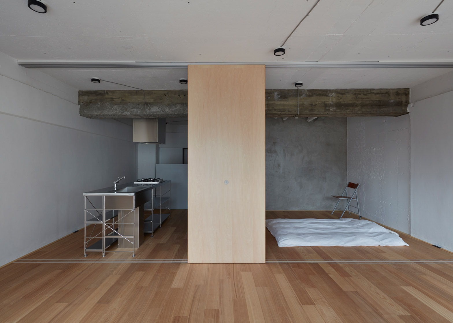 Small-Apartment-FrontOfficeStudio-Tokyo-Kitchen-and-Bedroom-Humble-Homes